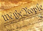 Close-up shot of the US Constitution, highlighting the words 'We the People'