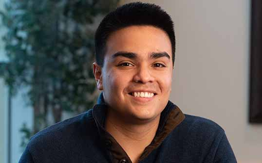 Andres Rodriguez smiles for a portrait photo at BYU-Idaho.