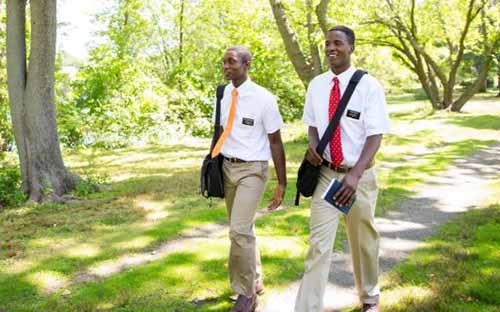 Missionaries walk together to their next appointment.