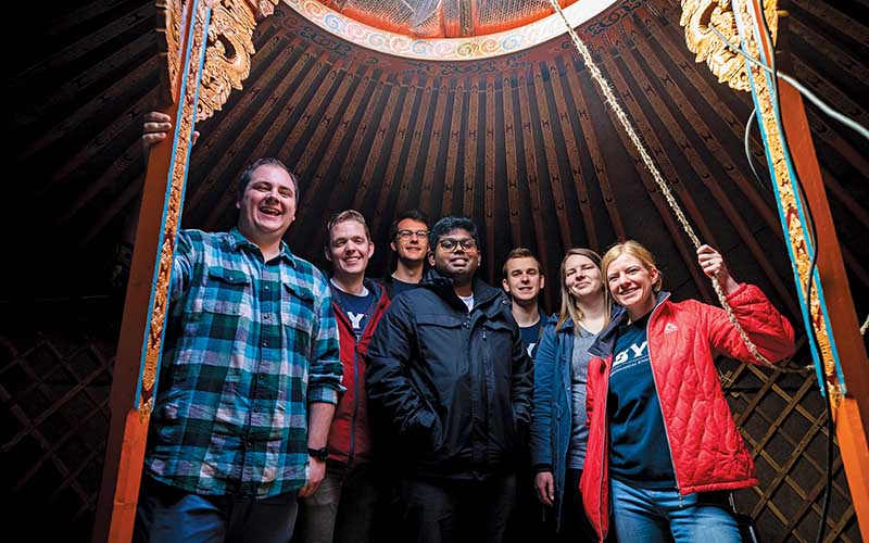 Seven BYU Engineering students in a Mongolian ger or tent house.