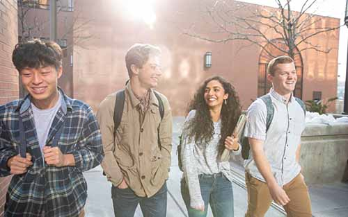 Students walking through the campus courtyard.