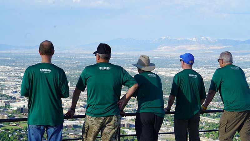 President Kusch and the President's Executive Council hiked Ensign Peak to introduce the college's new theme, Ensign Rising.