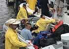 Rescuers in boats help victims of hurricane Harvey