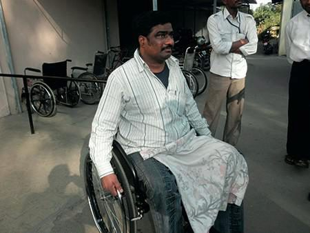 An Indian man in a Wheelchair
